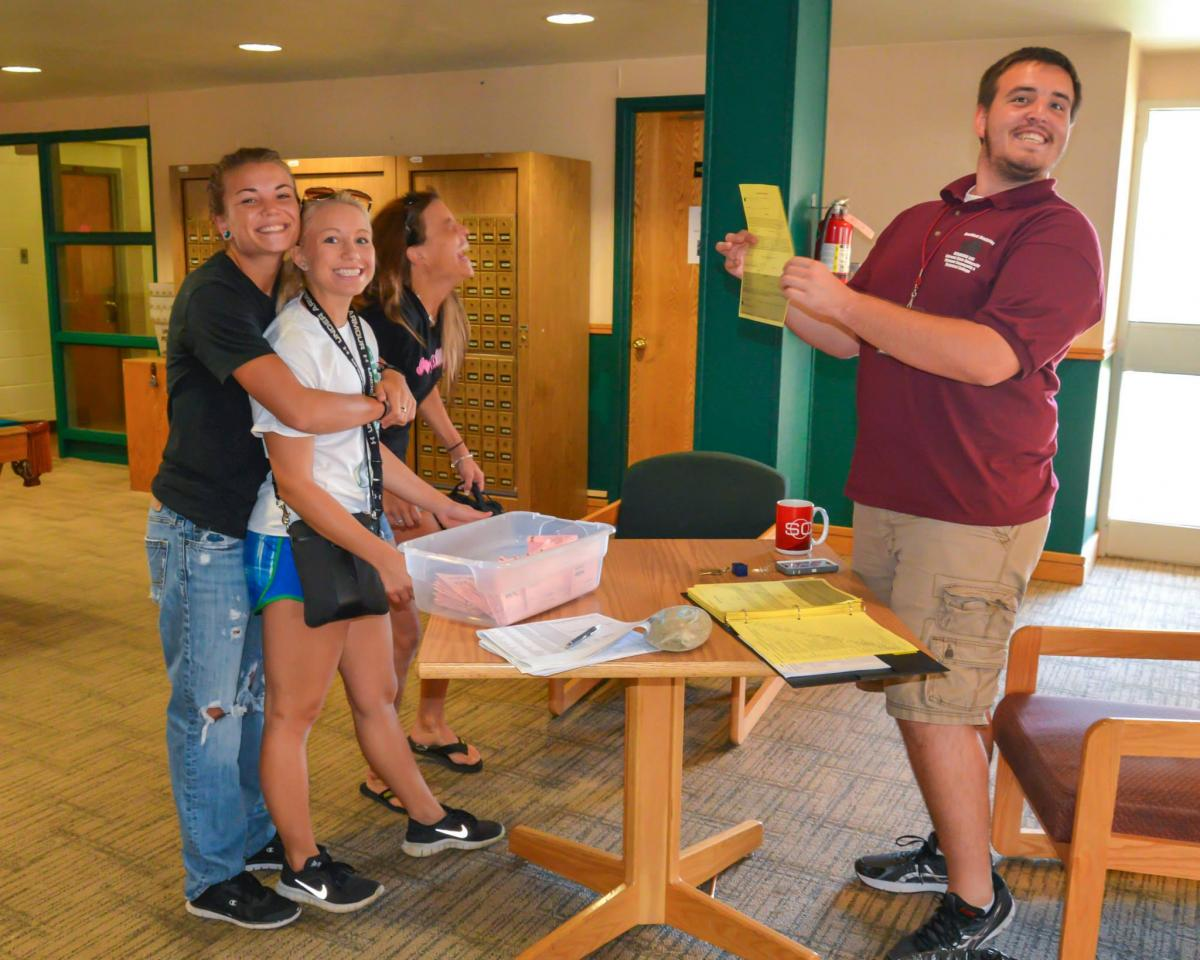 Residence Life Assistant Helping Students Move into the Dorm